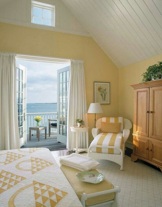 bedroom, white rug, yellow wall, white yellow striped chair, white bench with yellow cushion, wooden cabinet
