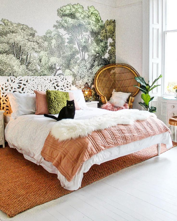 bedroom, white wooden floor, white wall, white detailed headboard, rattan chair, rattan rug
