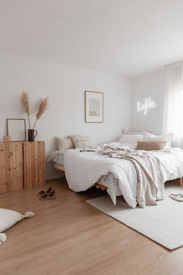 bedroom, wooden floor, white wall, wooden cabinet, wooden bed platform, white rug, white bedding