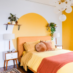 Bedroom, Wooden Floor, White Wall, Wooden Side Cabinet, Yellow Round Painted Pattern, Orange Bed Frame And Ehadboard, White Table Lamp
