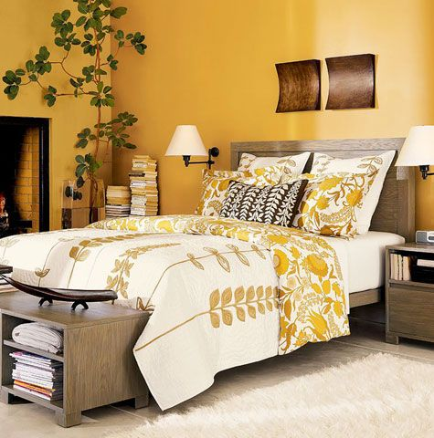 bedroom, wooden floor, yellow wall, wooden bed platform, white bedding, wooden side table, wooden bench