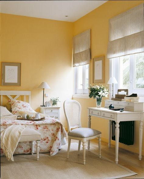 bedroom, yellow wall, wooden floor, white wooden table, white wooden chair, whie bench, white side cabinet