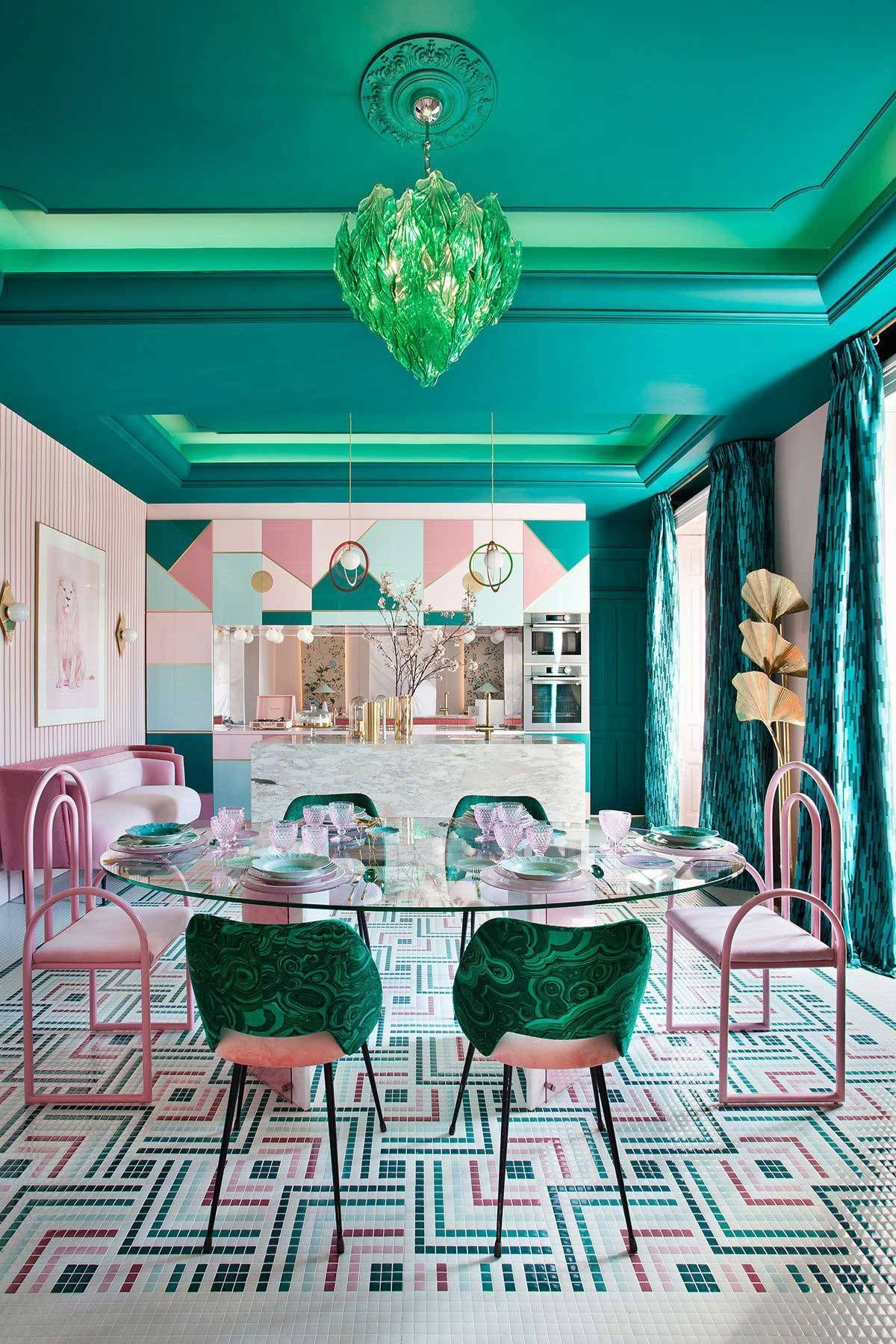 dining room, patterned floor, pink green chairs, green pendant, round glass dining table, pink wall, pink sofa, green curtain
