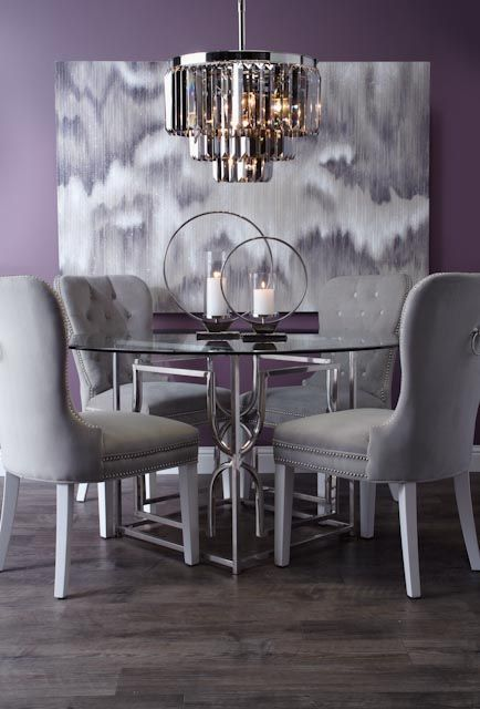 dining room, purple wall, white chairs, round glass top table, modern chandelier, wooden floor