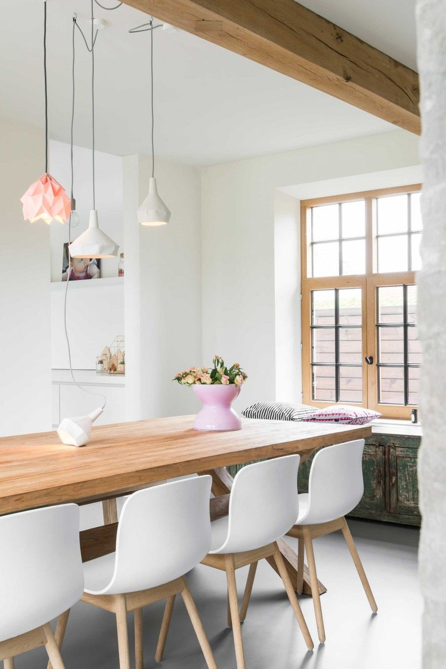 dining room, seamless floor, white wall, wooden table, white modern chairs, window seat, modern pendants