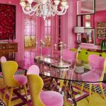Dining Room, White Black Patterned Rug, Pink Yellow Patterned Rug, Pink Yellow Chairs, Pink Wall, Oval Glass Dining Table, White Chandelier, Yellow Green Cabinet