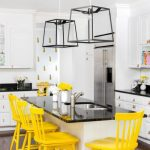 Dining Room, Woode Floor, White Wall, White Kitchen Cabinet, Black Top, Yellow Chairs