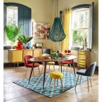 Dining Room, Wooden Floor, Crea Wall, Wooden Oval Table, Red, Yellow, Grey Modern Chairs, Wooden Cabinet, Green Pendant