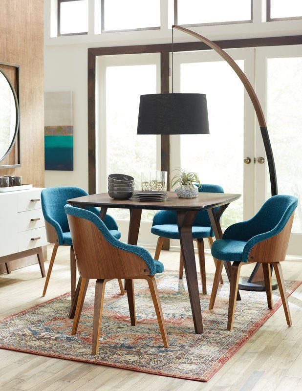 dining room, wooden floor, ug, brown table, blue chairs, black curvy floor lamp, white cabinet
