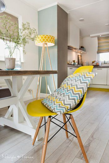 dining room, wooden floor, white wall, brown white wooden table, yellow modern chair, yellow floor lamp