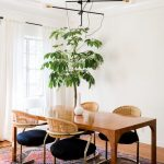 Dining Set, Wooden Table, Iron Chairs With Rattan Back, Wooden Floor, Patterned Rug, White Wall, Pendants
