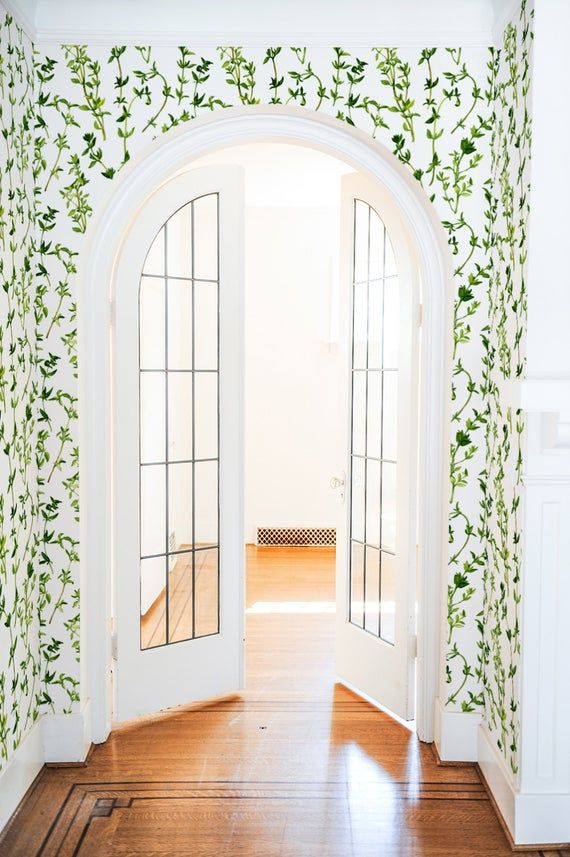 entrance, white curvy door framed, white green wallpaper