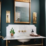 Golden Sconce With Clear Lamp, White Marble Sink