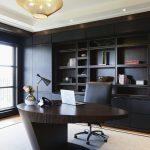 Home Office, Wooden Floor, White Rug, Black Built In Shelves, Wooden Table, Black Office Chair, Golden Pendants