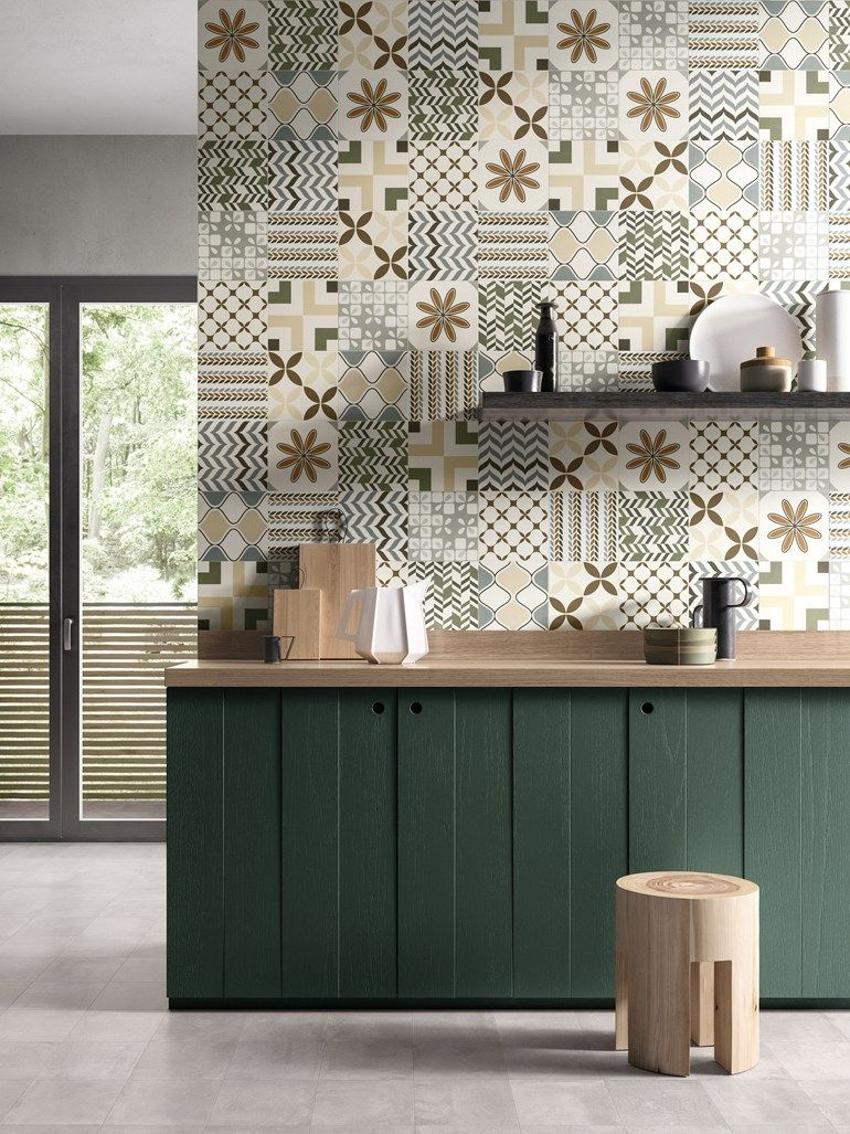 kitchen, seamless grey floor, patterned tiles on backsplash, dark green kitchen cabinet, wooden top, black floating shelves