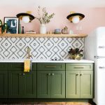 Kitchen, Wooden Floor, Patterned Rug, Pink Wall, Wooden Floating Shelves, Golden Pendants, Green Kitchen Cabinet, White Top