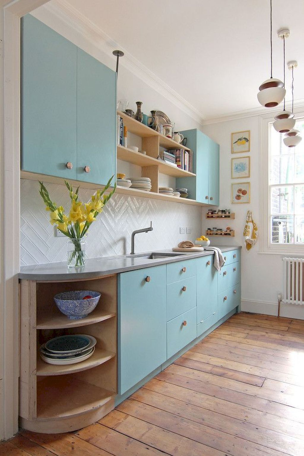 kitchen, wooden floor, white herringbone backsplash, blue kitchen cabinet, wooden shelves, grey top
