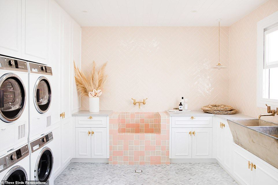 laundry room, cream wall, white cabinet, pastel orange sink, brown sink