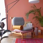 Living Room Chair, Wooden Floor, Grey Pink Cushion On Wooden Chair Frame, Peach Wall, Pink Patterned Rug