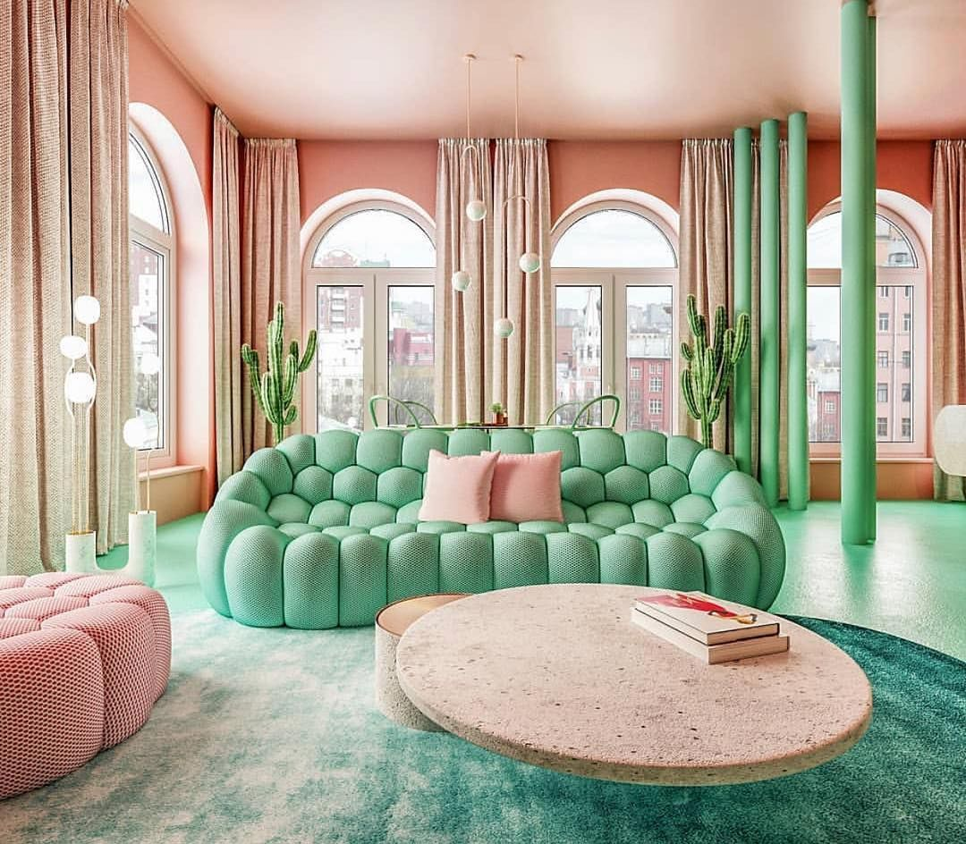 living room, green floor, pink wall, brown curtain, green sofa, pink ottoman, brown round coffee table