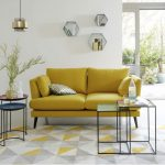 Living Room, Grey Yellow Patterned Rug, White Wall, Indented Shelves, Yellow Sofa, Nesting Tray Coffee Table,s