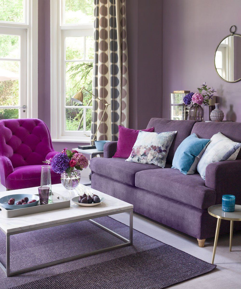 living room, light purple floor, purple rug, white coffe table, purple sofa, pink chair, purple wall, mirror