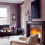Living Room, Purple Wall, Rug Floor, Marble Fireplace, Pink Sofa, Round Coffee Table, White Chair