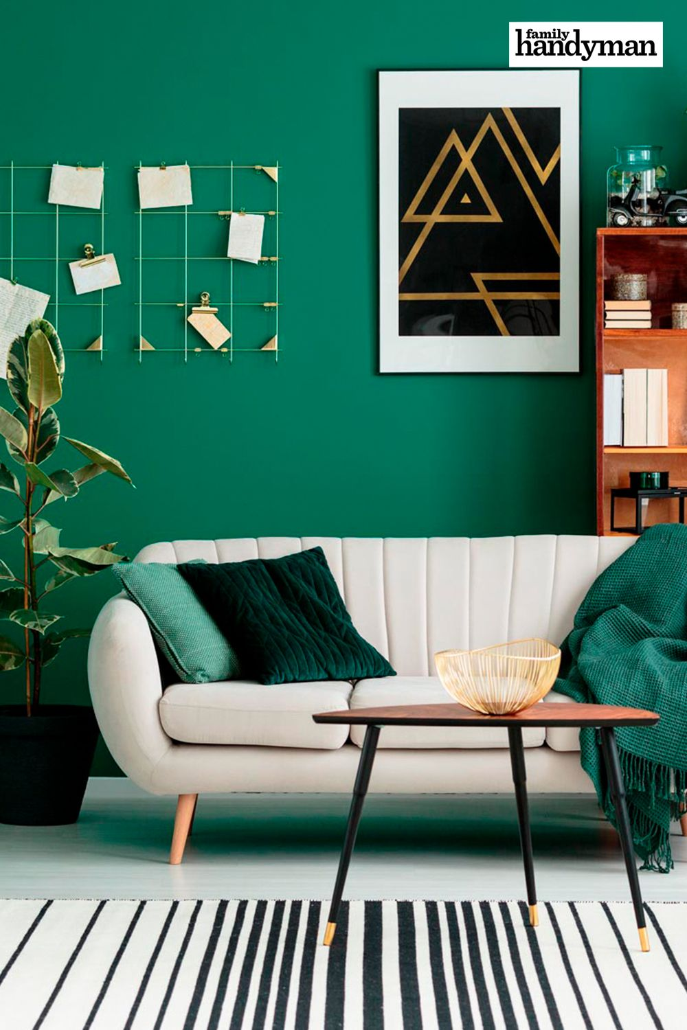 living room, white floor, green wall, white sofa, black plant pot, coffee table