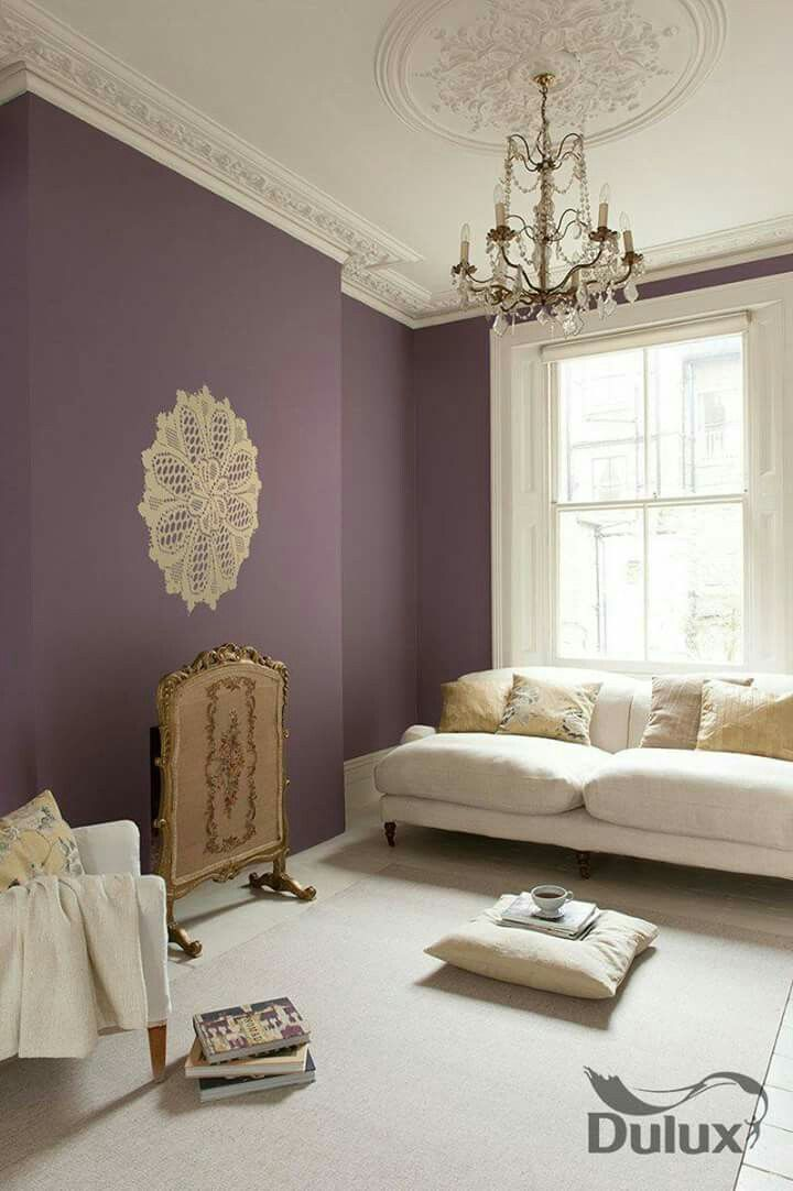 living room, white floor tiles, white rug, purple wall, white sofa, wihte chair,