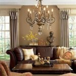Living Room, White Rug, Brown Leather Sofa, Brown Wooden Coffee Table, Patterned Chair And Ottoman, Brown Wal, Brown Curtain, Chandelier, Wooden Cabinet