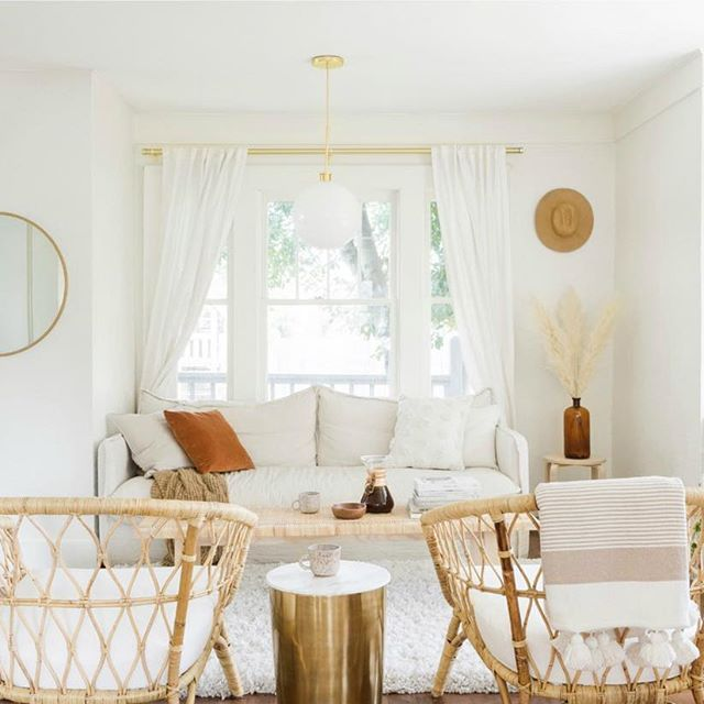 living room, white rug, white wall, white pendants, white sofa, rattan chairs, wooden side table
