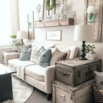 Living Room, White Wall, White Sofa, White Table Lamps, Suitcases Side Table, Wall Accessories