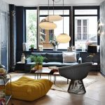Living Room, Wooden Floor, Blue Wall, Blue Sofa, Yellow Ottoman, Black Frame Chair, Coffee Table, White Pendants