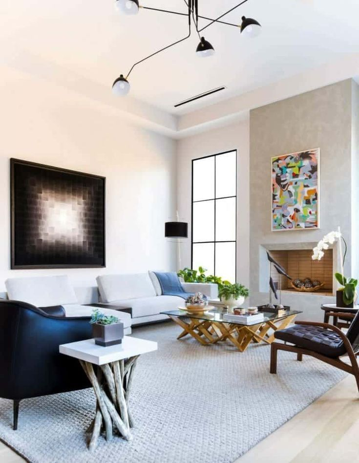 living room, wooden floor, grey rug, white sofa, black lounge chair, black leather chair, coffee table, side table, modern chandelier