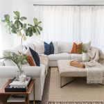 Living Room, Wooden Floor, Jutted Rug, Ottoman Coffee Table, White Corner Sofa, Side Table, Plants