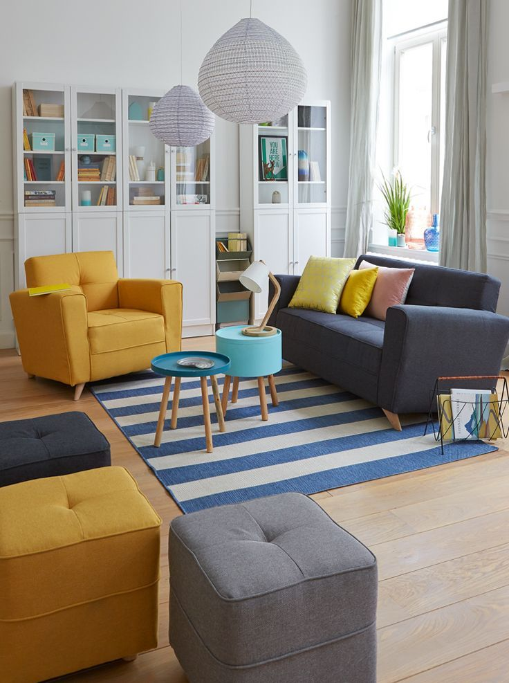 living room, wooden floor, white cabinet, white wall, grey curtain, yellow chair, grey sofa, blue tray coffee table, blue coffee table, grey ottoman, yellot ottoman,