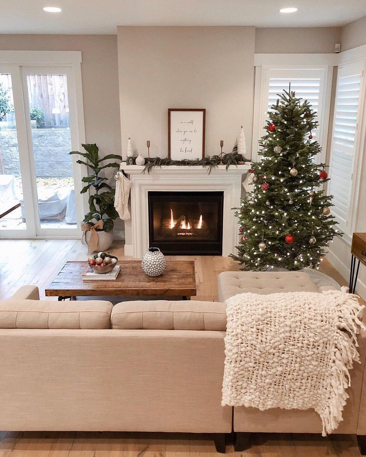 living room, wooden floor, white sofa, wooden coffee table, white wall, white fireplace, christmas tree