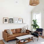 Living Room, Wooden Floor, White Wall, Brown Leather Sofa, Wooden Coffee Table With White Marble Top, Wooden Chair With Black Cushion, Rattan Pendant