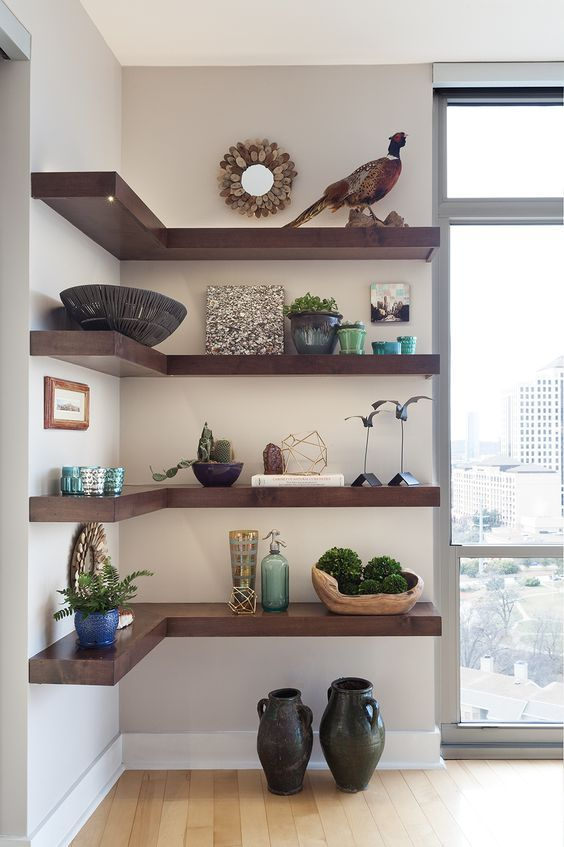 living room, wooden floor, white wall, corner wooden shelves