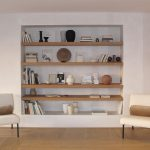 Living Room, Wooden Floor, White Wall, White Nook With Wooden Floating Shelves, White Chairs