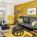 Living Room, Wooden Floor, Yellow Wall, White Wall, Yellow Chairs, Grey Sofa, Black Rocking Chair, Black Coffee Table, Black Floor Lamp
