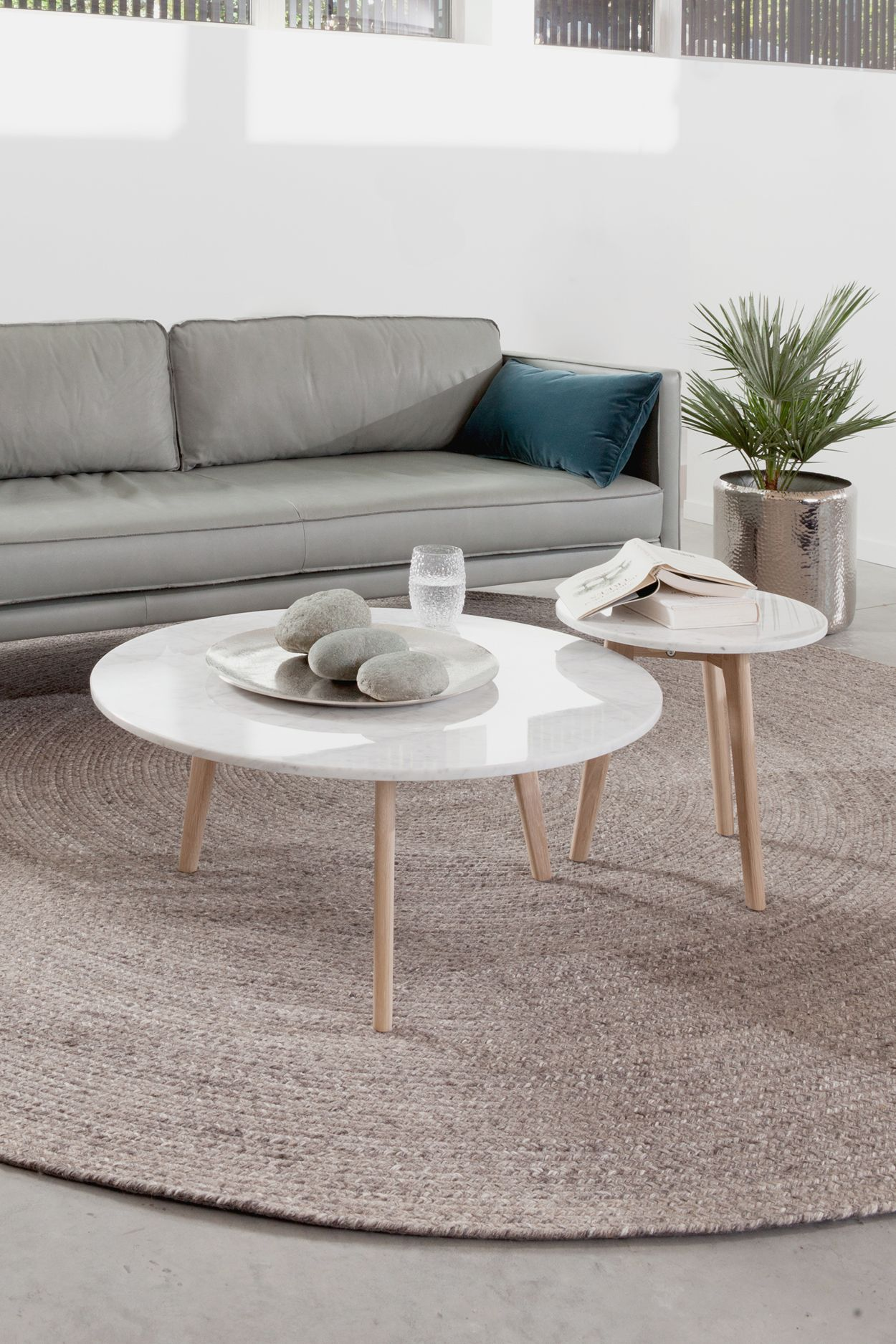 nesting table, white marble top, grey rattan rug, grey sofa, seamless floor