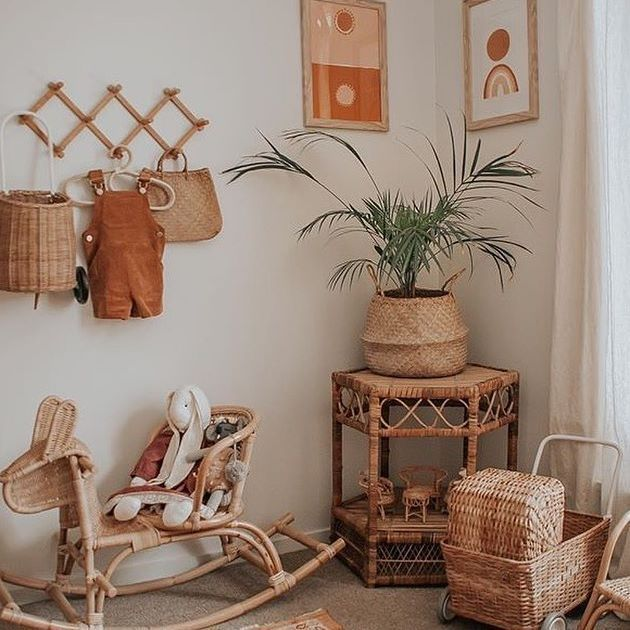 nursery, brown floor, white wall, rattan side table, rattan pot, rattan toys, wooden hooks