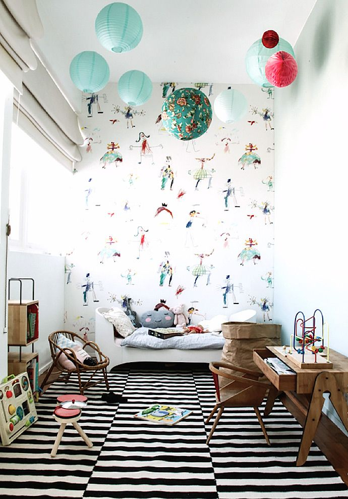 nursery, white wall, wallpaper, green paper lanterns, white curtain, wooden floor, striped rug, wooden child study table, rattan chair