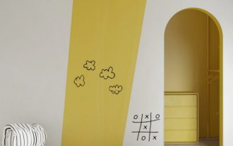 nursery, white wall, yellow, white ottoman, white round rug, yellow cabinet