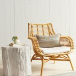 Rattan Chairs With White Cushion, White Wooden Wall, White Side Table, White Wooden Floor, Grey Rug