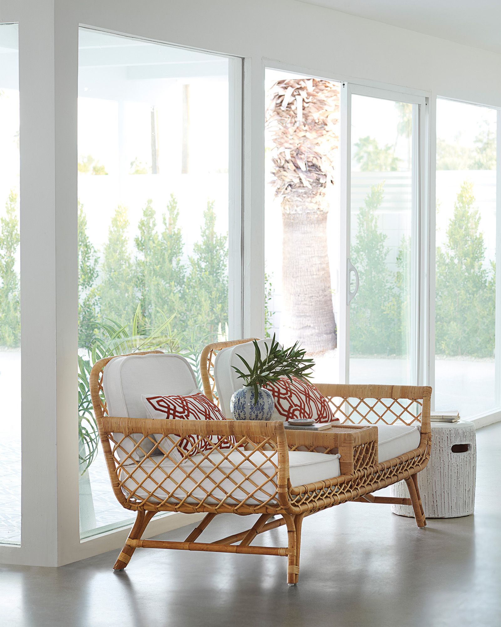 rattan combined chairs with small table between, white cushion