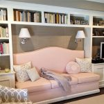 Reading Nook, White Built In Shelves, Brown Wall, Pink Sofa, White Sconces