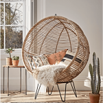 Round Rattan Chair, Wooden Floor, White Wall, Patterned Rug, Wooden Side Table