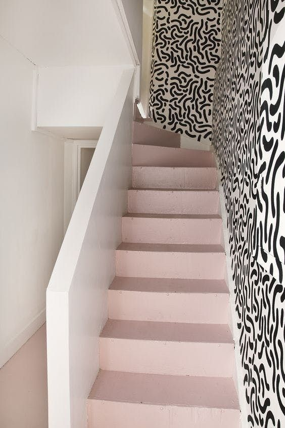 stairs, light pink stairs, patterned wall